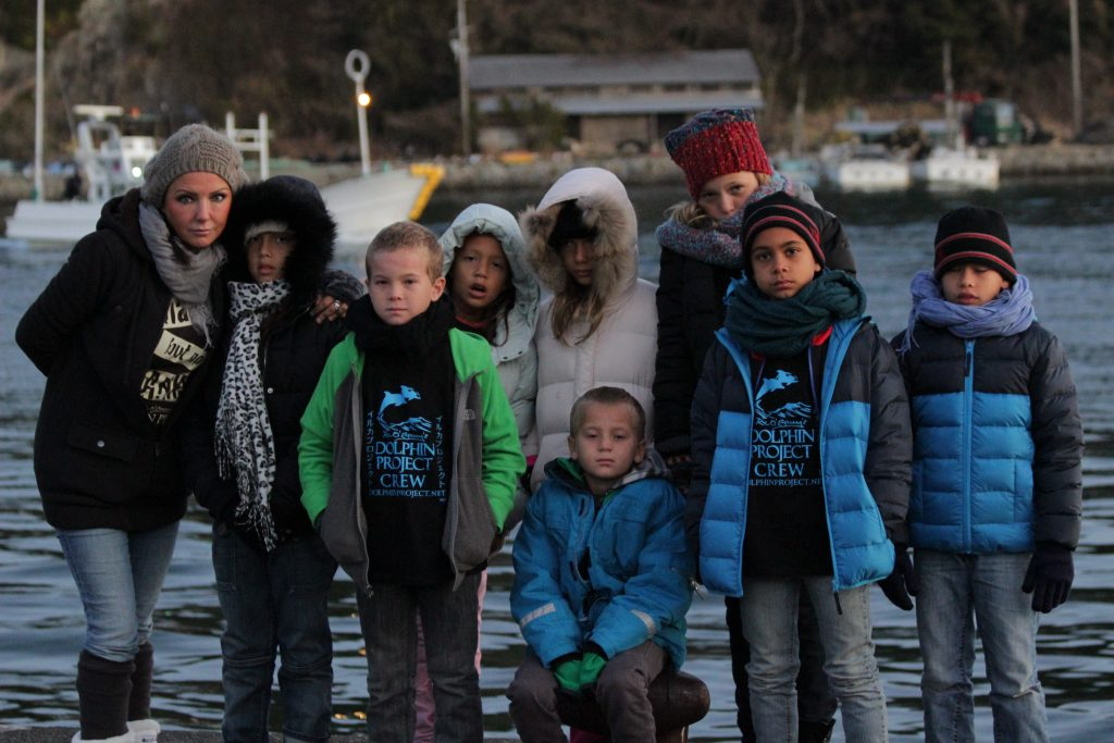 Children from Gecko Community in Taiji, with Vicki Kiely (far left). Image: Dolphin Project